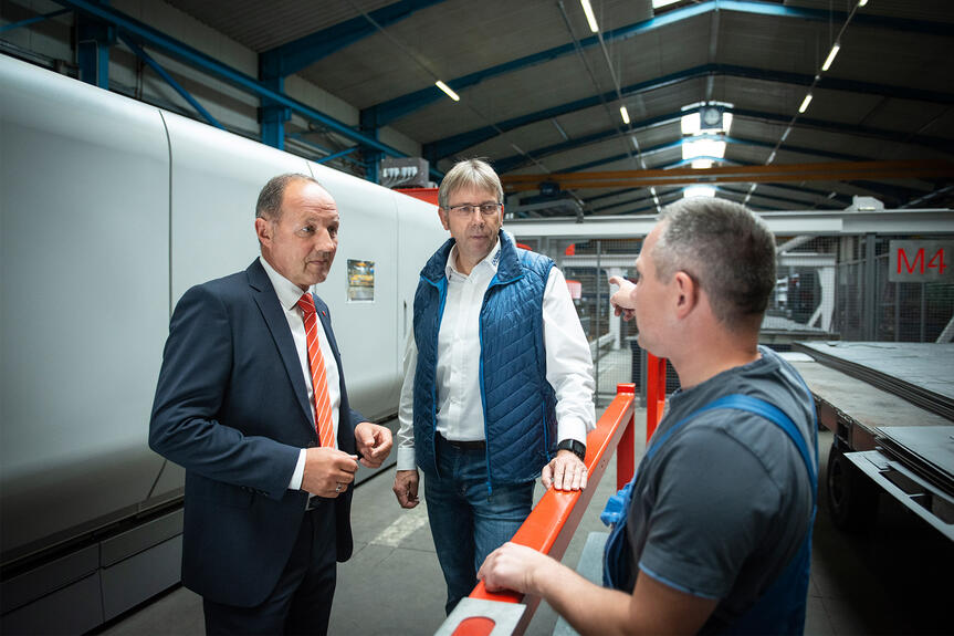 "Jörg Zechel, Bystronic Sales Manager North, (on the left) says: ""The turnkey solution comprising laser cutting system, automation, software, and service was developed in close cooperation between Bystronic and Langen CNC Metalltechnik. The package we implemented is unique on the market."""